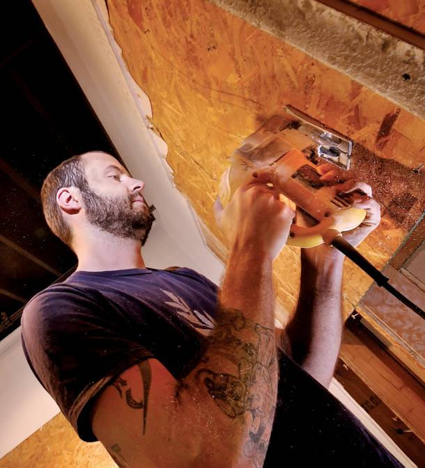 Chicago artist Scott Carter works on his installation opening at the Contemporary Arts Center