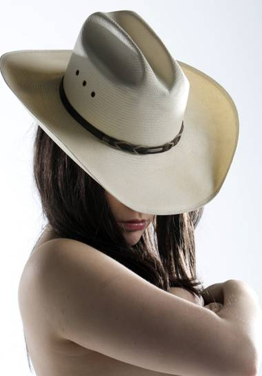 I learned that there's a custom: If you try on the hat, you have to try on the cowboy.