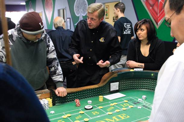 Instructor Tommy Manning shows Crescent students the ropes. Many of them take a comprehensive course that teaches them table games from craps and poker to roulette and blackjack.