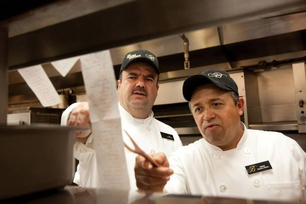 Jose de la Torre, left, and Aaron Lanoz demand the best from one another at Bellagio's breakfast station.