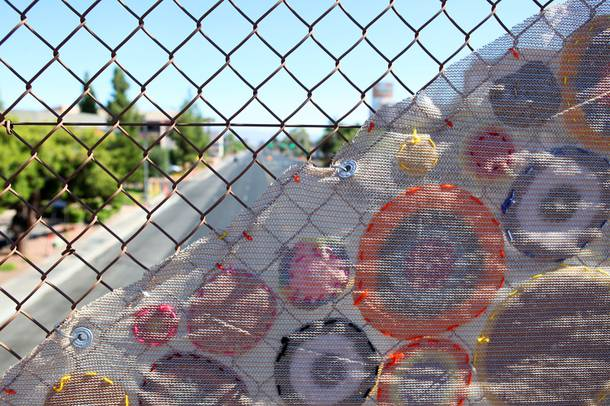 A public art project is installed on the pedestrian bridge across Maryland Parkway north of Desert Inn Road in Las Vegas on Monday, June 11, 2012.