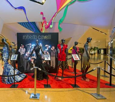 Roberto Cavalli gowns, worn by A-listers on the red carpet, are on display at Crystals through August 3.