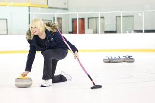 Peggy Pennington curls at Las Vegas Ice Center