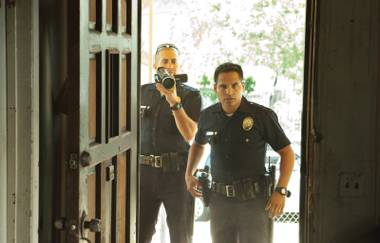 Jake Gyllenhaal and Michael Peña are stuck in a propaganda film called End of Watch.