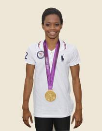 Gold medalist Gabby Douglas performs at the T&M Thursday night.