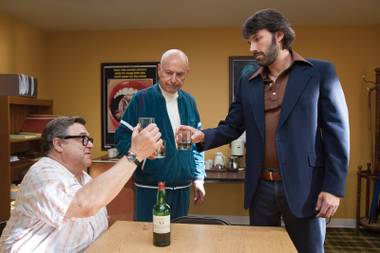 Argo's power trio: Goodman, Arkin and Affleck toast their fake movie.