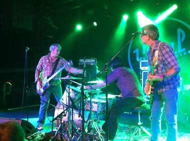 Mike Watt (left) gestures toward the drums during Saturday's Missingmen show at Vinyl.