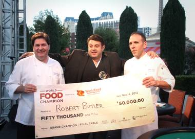 Chef Robert Butler, right, and chef Lowell McCain, left, took the ultimate title at the World Food Championships with Adam Richman on November 4.