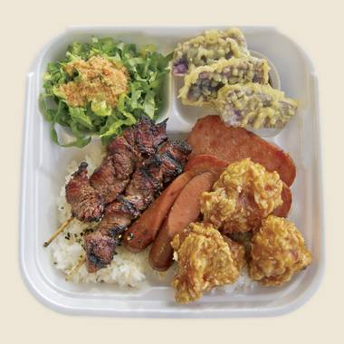 Rice Trax Teriyaki Grill's garlic bento box is loaded with garlic chicken, beef teriyaki, Spam and a hot dog.