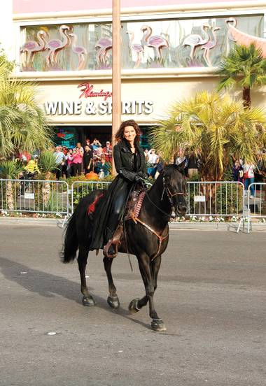 That DOES impress me much: Shania Twain and her trusty steed trot the Boulevard.