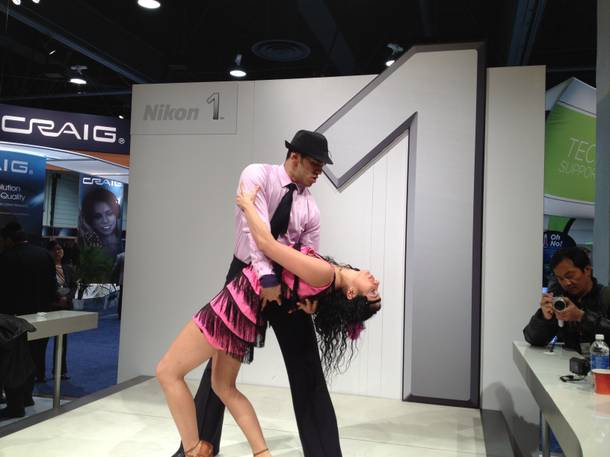 Miguel and Patricia swing fringe to demonstrate the quick-action capture of Nikon cameras.