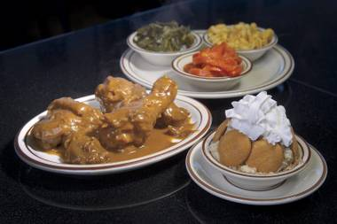 An ideal meal: smothered chicken with plenty of sides and banana pudding for dessert at M&M Soul Food.