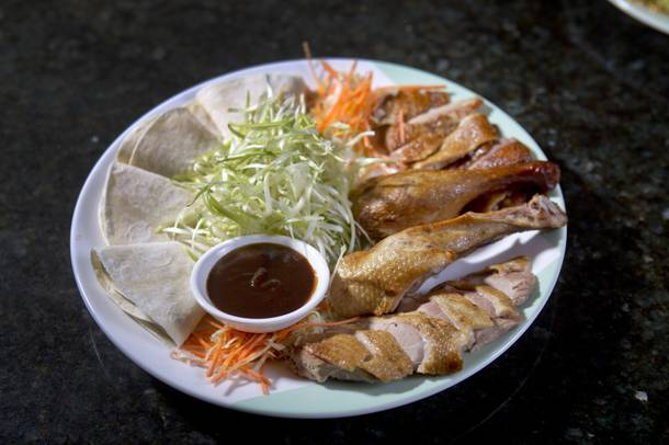 Ping Pang Pong's tea-smoked duck, served with mu shu pancakes.