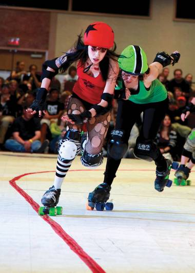 Catch rollergirls Cherry Potter (left) and Stella Blue in action Saturday night at South Point.