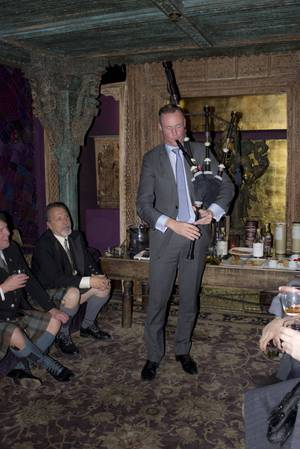 Lorne Cousin, brand ambassador for Balvenie, shows off his bagpipe skills.
