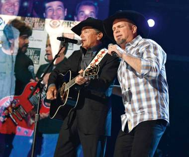 "Garth Brooks joined George Strait onstage at the ACM Awards Strait's ""The Cowboy Rides Away."""