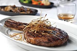 The 32-ounce tomahawk ribeye at Andiamo will satisfy any appetite.