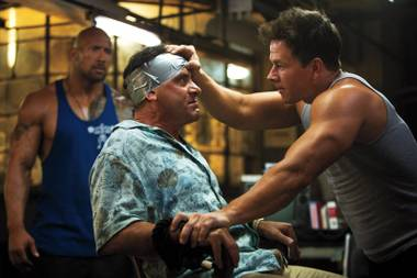 Muscleheads: Wahlberg lets Shalhoub know who's boss.
