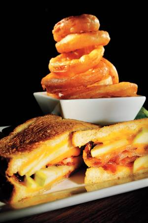 Try the green apple, bacon and cheddar grilled cheese at Aces & Ales.