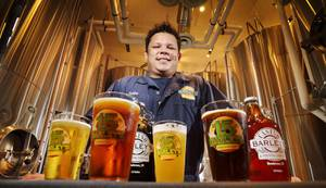 Barley's brewmaster, Bubba, shows off his crop of beers.