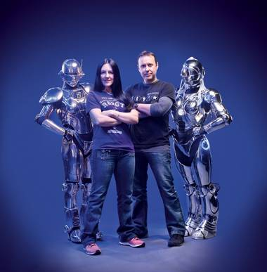 Amanda Deacon and Ian Herrington with a pair of their part-human, part-machine Showbots.