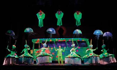 It's fabulous being green. The costumes in Priscilla Queen of the Desert make EDC look tame.