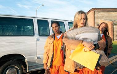 Taylor Schilling, center, portrays Piper Kerman, whose memoirs are the basis for the Netflix series Orange Is the New Black.