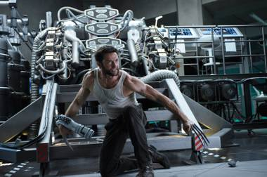 Claws out: Jackman brandishes his familiar weapons at his enemies.