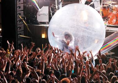 Be the ball: The Flaming Lips roll into the House of Blues Thursday night.