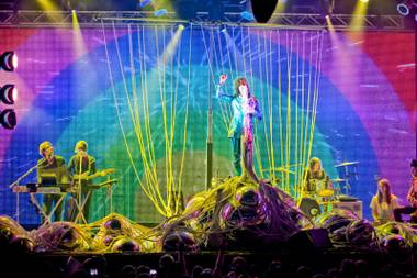 Thursday night's Flaming Lips set at the House of Blues invited fans to step into a throbbing chrome-and-LED cavern.