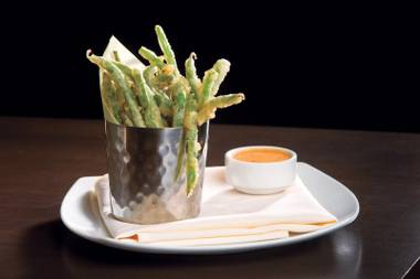 Heraea's crispy green beans are a fresh alternative to your standard sports bar snack.