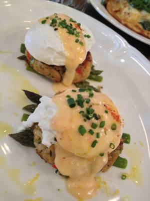 Honey Salt's crab cake benedict comes with asparagus, poached eggs and tomato Hollandaise.