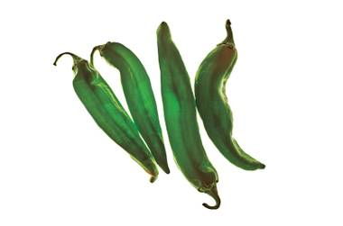 You don't want to mess with raw Hatch chiles. Roast 'em up, or buy batches of already roasted peppers at local stores like Whole Foods.