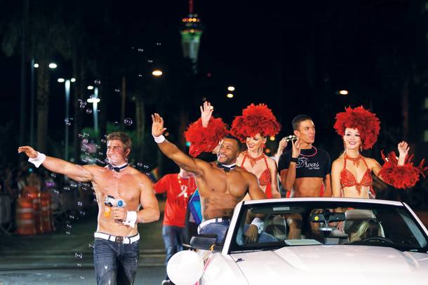 Many local organizations join in on the Pride parade fun, including the casts of Chippendales and Divas.