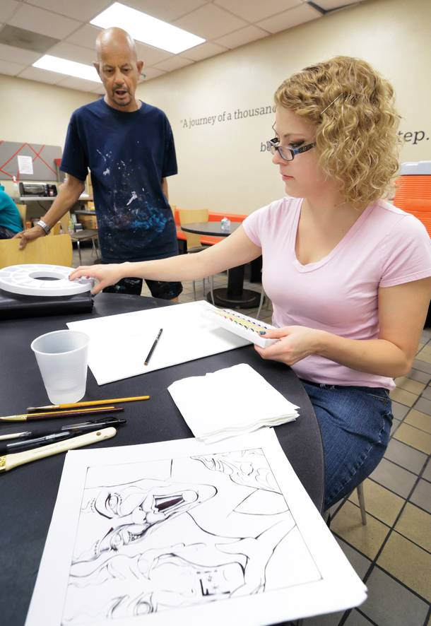 Nikki Paskevicius prepares a painting during a Saturday morning art class at Shannon West Homeless Youth Center.