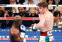 Boxing fans took to social media to say they could do a better job than judge C.J. Ross (pictured between the boxers in the background) ...