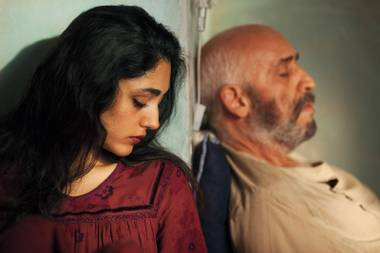 The unnamed heroine of The Patience Stone, played by Golshifteh Farahani, left, watches over her wounded husband, played by Hamidreza Javdan.
