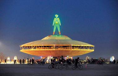 "The ""Man"" sculpture is illuminated at the Burning Man festival in Gerlach, Nevada, this past August."
