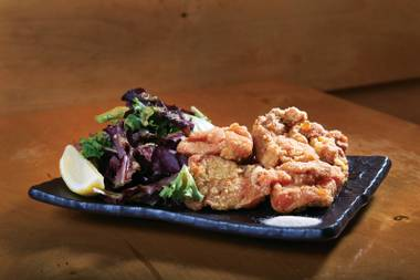 Fukumimi's karaage, tender pieces of lightly fried dark-meat chicken, is one of our favorite versions of this simple dish.