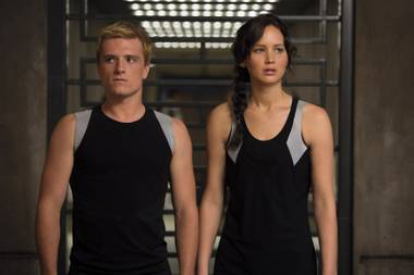 Josh Hutcherson and Jennifer Lawrence compare sculpted shoulders as they prepare for another fight to the death in The Hunger Games: Catching Fire.