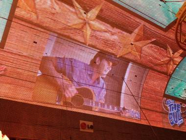 Projected on the Fremont canopy, Rodney Atkins was also live onstage during the Downtown Hoedown. It was cold as hell, but the bands played on.